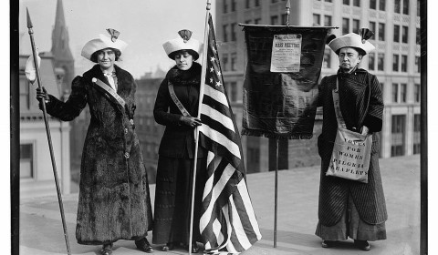 suffragettes with flags