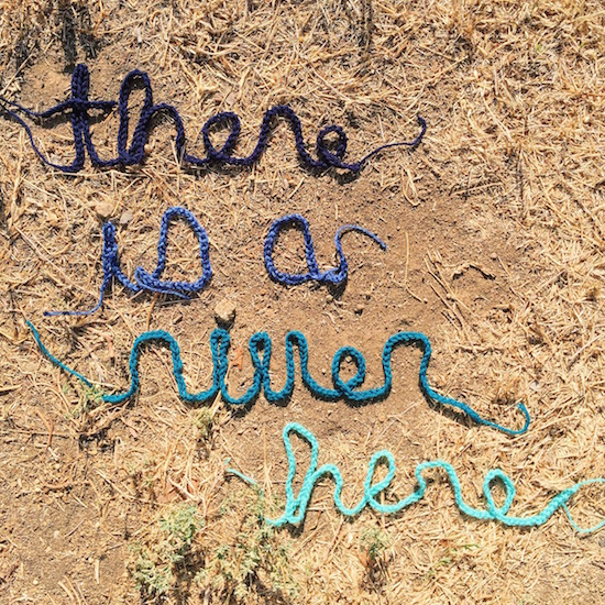 There Is A River Here project sign created by Liz Flynn. Courtesy @thereisariverhere Instagram.